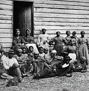Abolition Photos - A Group Of Slaves by Photo Researchers
