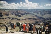 A Group Of Visitors At Hopi Point Print by Justin Locke