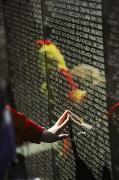 Vietnam Veterans Memorial Photos - A Hand Reaches Out To Touch A Name by Steve Raymer