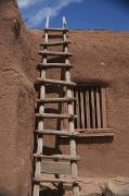 Santa Fe Framed Prints - A Handmade Wooden Ladder Rests Framed Print by Stacy Gold