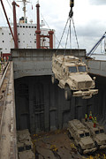 Mrap Photos - A Harbor Crane Lifts A Mine-resistant by Stocktrek Images
