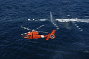 Helicopters Prints - A Helicopter Crew Trains Off The Coast Print by Stocktrek Images