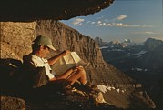 Charts And Diagrams Framed Prints - A Hiker Pauses To Rest And Read A Map Framed Print by Gordon Wiltsie