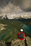 Scenic Overlooks Prints - A Hiker Takes In The Panoramic View Print by Michael Melford