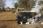 Hmmwv Framed Prints - A Humvee Burns After A Simulated Framed Print by Stocktrek Images