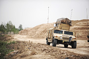 Hmmwv Posters - A Humvee Conducts Security Poster by Stocktrek Images