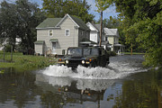 Suburb Posters - A Humvee Drives Through The Floodwaters Poster by Stocktrek Images