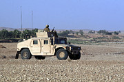 Hmmwv Posters - A Humvee Filled With Marines Conducting Poster by Stocktrek Images