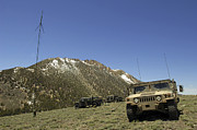 Transmitting Framed Prints - A Humvee Is Parked Framed Print by Stocktrek Images