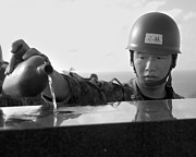 Fallen Soldier Photos - A Japanese Soldier Pours Water by Stocktrek Images