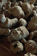 Qin Prints - A Jumbled Heap Of Terra-cotta Heads Print by O. Louis Mazzatenta