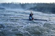 Kayaking Posters - A Kayaker Takes On White Water Rapids Poster by Kenneth Garrett