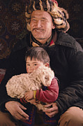 Juvenile Mammals Posters - A Kazakh Eagle Hunter And His Son Poster by David Edwards