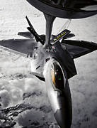 Jetfighter Posters - A Kc-135 Stratotanker Refuels A F-22 Poster by Stocktrek Images
