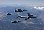 Flying Photos - A Kc-135r Stratotanker Refuels Three by HIGH-G Productions
