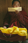 Buddhist Clergy Framed Prints - A Lama Studies Tibetan Scripture Framed Print by David Edwards