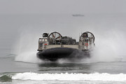 Boats On Water Photo Posters - A Landing Craft Air Cushion Comes Poster by Stocktrek Images