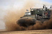 Beachhead Posters - A Landing Craft Air Cushion Coming Poster by Stocktrek Images