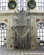 Chandelier Prints - A Large Crystal Chandelier In The Ortaköy Mosque Print by Andrew Rowat