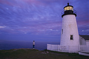 Maine Lighthouses Posters - A Lighthouse Visitor Enjoys A Twilight Poster by Stephen St. John