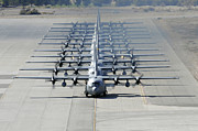 Taxiway Posters - A Line Of C-130 Hercules Taxi At Nellis Poster by Stocktrek Images