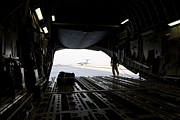Airfield Framed Prints - A Loadmaster Guides The Pilot Of A C-17 Framed Print by Terry Moore