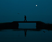 Sea Moon Full Moon Photo Prints - A lone man Print by Jasna Buncic