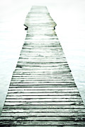 Infinity Prints - A long and old wooden bridge into the bright light Print by Joana Kruse