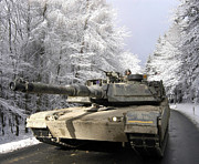 Snow On Road Posters - A M-1a Abrams Tank Drives Poster by Stocktrek Images