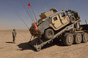 M1114 Prints - A M1114 Armored Vehicle Is Unloaded Print by Stocktrek Images