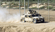 M1114 Prints - A M1114 Humvee Patrols The Perimeter Print by Stocktrek Images