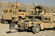 Combat Vehicles Framed Prints - A M1114 Humvee Sits Parked In Front Framed Print by Stocktrek Images