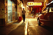 City Streets Posters - A Man And A Taxi On A Shop-lined Hong Poster by Justin Guariglia