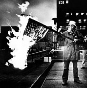 Crisis Posters - A Man Burns An American Flag Poster by Everett