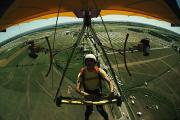 Fly In Posters - A Man Flies In A Hang Glider Powered Poster by James A. Sugar