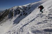 Ledge Photos - A Man Hikes Up Tuckermans Ravine by Tim Laman