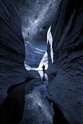 Milky Digital Art - A man hiking in a Lake Powel slot canyon at night with Milky Way by Bryan Allen