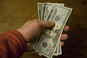 Money Prints - A Man Holds A Handful Of Paper Currency Print by Taylor S. Kennedy