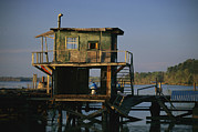 Etc. Photos - A Man Sits On A Pier Near A Dilapidated by Raymond Gehman