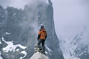 Standing Out From The Crowd Posters - A Man Stands On A Cliff Watching Poster by Jimmy Chin