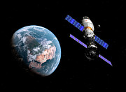 Space Travel Art - A Manned Soyuz Tma-m Spacecraft Docked by Walter Myers