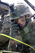On The Phone Prints - A Marine Communicates Over The Radio Print by Stocktrek Images