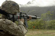 Target Field Posters - A Marine Conducts Drills With An M16-a2 Poster by Stocktrek Images