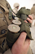 40mm Posters - A Marine Cradles Handfuls Of 40 Mm Poster by Stocktrek Images