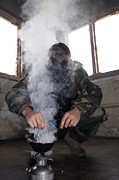Biological Photo Posters - A Marine Fills The Gas Chamber Poster by Stocktrek Images