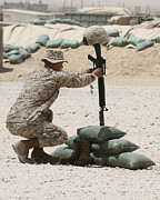 Fallen Soldier Photos - A Marine Hangs Dog Tags On The Rifle by Stocktrek Images