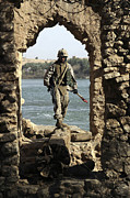 Baghdad Framed Prints - A Marine Searching A Stone Aqueduct Framed Print by Stocktrek Images