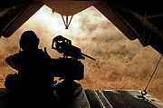 Dust Clouds Prints - A Marine Waits For Dust To Clear While Print by Stocktrek Images