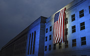 Pentagon Prints - A Memorial Flag Is Illuminated On The Print by Stocktrek Images