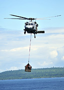 Pallet Framed Prints - A Mh-60 Knighthawk Carries Supplies Framed Print by Stocktrek Images